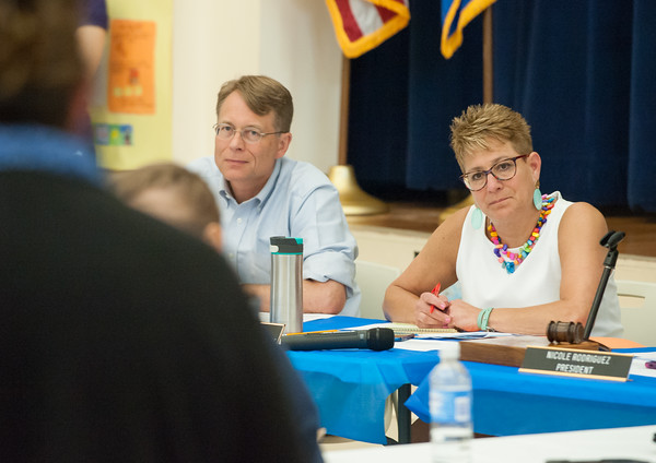 05/21/18 Wesley Bunnell   Staff A meeting of the New Britain Board of Ed took place to a packed standing room only crowd at Vance School on Monday night regarding recently announced changes for the upcoming 18-19 school year. Board members Merrill Gay and Superintendent of Schools Nancy Sarra listen to a speaker.
