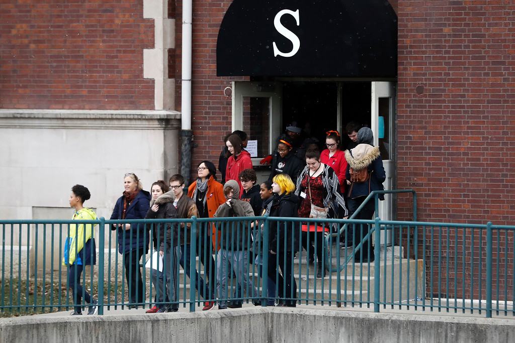 . Students exit the building before gathering on their soccer field during a 17-minute walkout protest at the Stivers School for the Arts, Wednesday, March 14, 2018, in Dayton, Ohio. Students across the country planned to participate in walkouts Wednesday to protest gun violence, one month after the deadly shooting inside a high school in Parkland, Fla. (AP Photo/John Minchillo)
