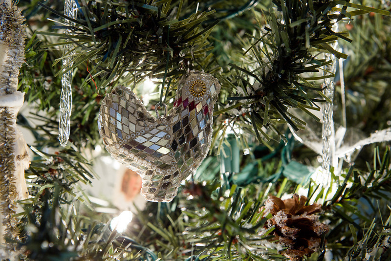 . A mirrored hen -- or perhaps a partridge? -- adds sparkle to one of the Christmas trees at the Boettcher mansion. Photo by Mark Broste