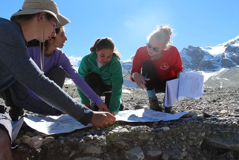 Pearson, Heba, Sarah, and Sarah working on their geology lab
