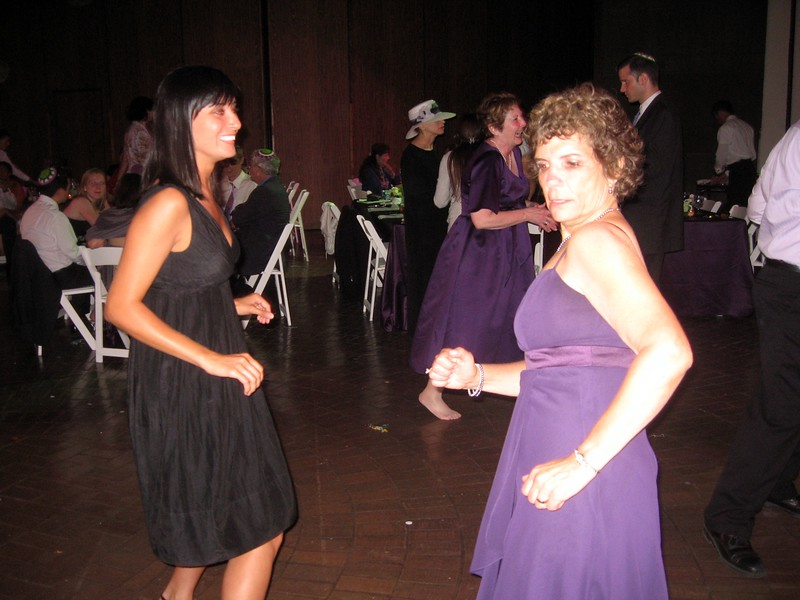 Hope (mother of the bride, right) dances with Amber (girlfriend of the brother of the bride)