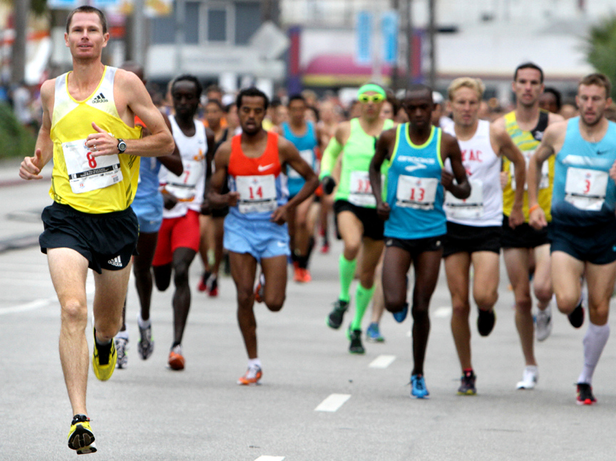 . Ben Bruce of Flagstaff, Arizona looks strong as he takes an early lead during the 2013 Wharf to Wharf race in Santa Cruz on Sunday. (Kevin Johnson/Sentinel)