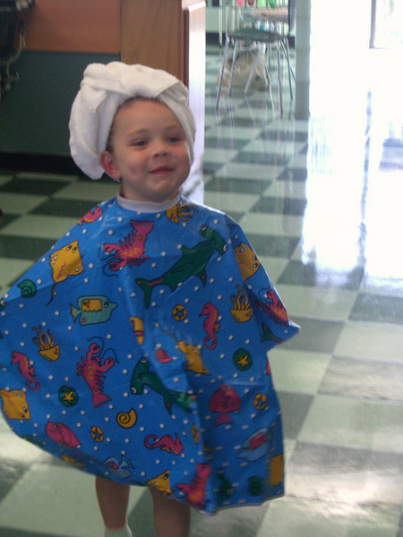 As you can tell, she was loving the spa treatment. Her very first haircut! 7.12.2008