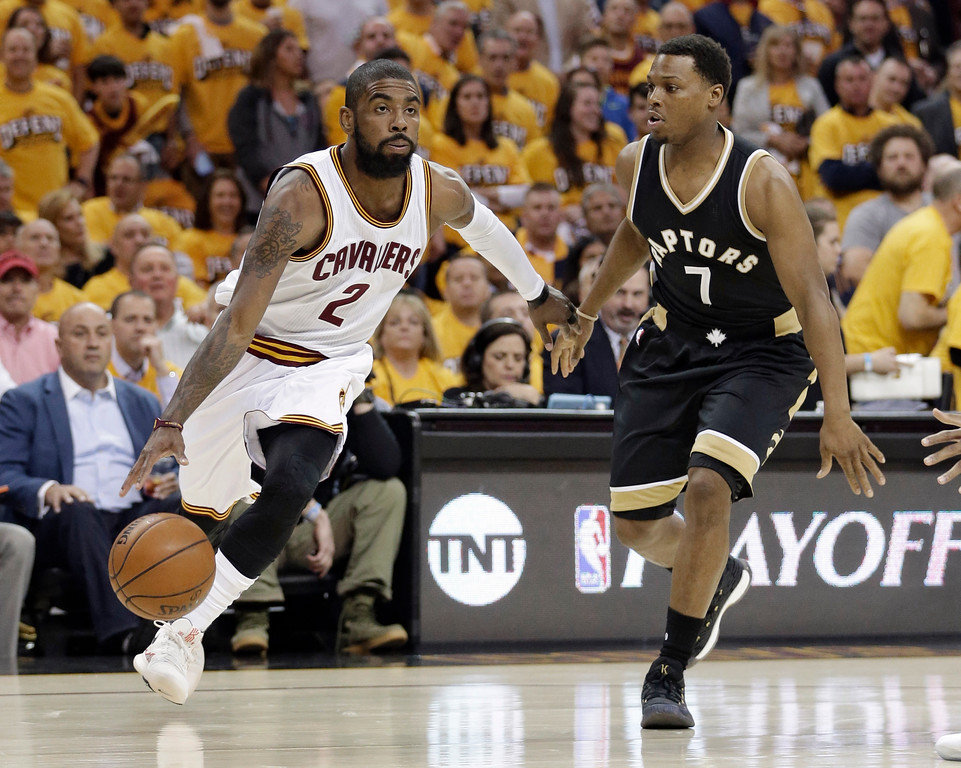 . Cleveland Cavaliers\' Kyrie Irving drives past Toronto Raptors\' Kyle Lowry during the first half in Game 2 of the second round of the NBA playoffs on May 3 in Cleveland. The Cavaliers won 125-103, to lead the series 2-0. Irving led the team in assists (11), LeBron James led in points (39) and Tristan Thompson led in rebounds (9).(AP Photo/Tony Dejak)