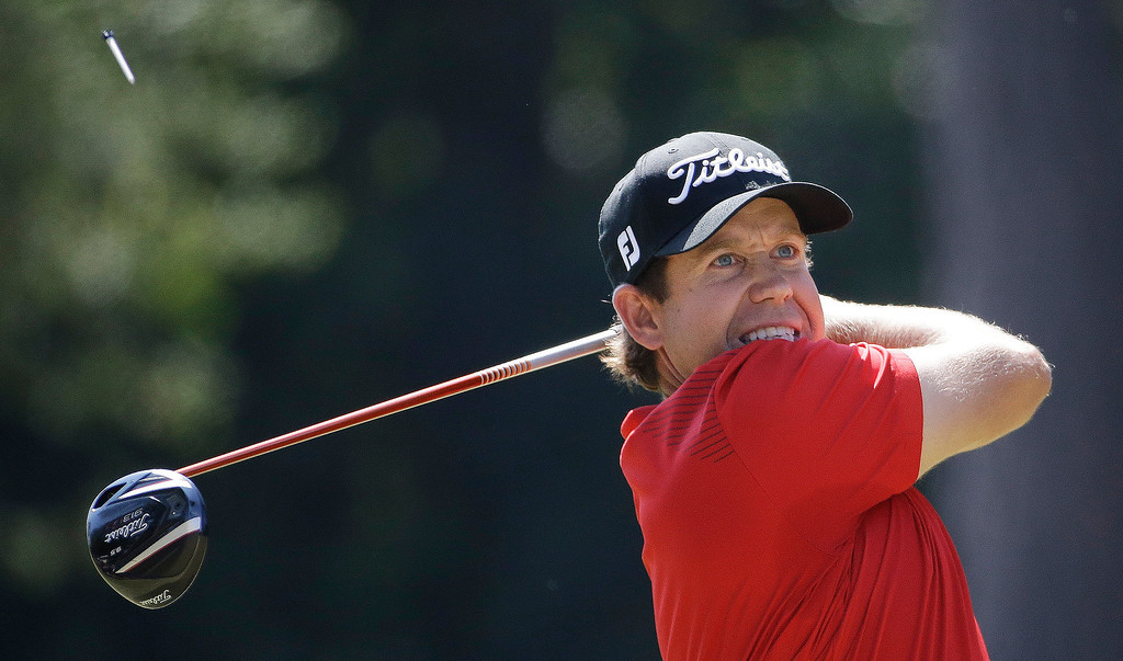 . Erik Compton watches his tee shot on the third hole during the final round of the U.S. Open golf tournament in Pinehurst, N.C., Sunday, June 15, 2014. (AP Photo/David Goldman)