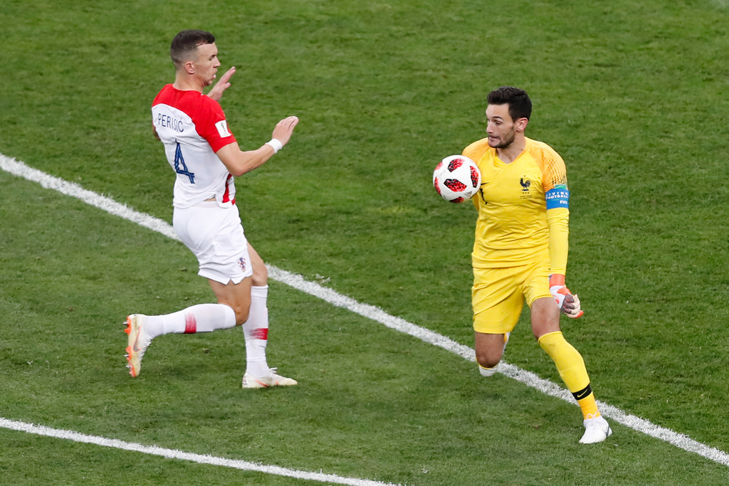 . France goalkeeper Hugo Lloris controls the ball outside the area in front of Croatia\'s Ivan Perisic during the final match between France and Croatia at the 2018 soccer World Cup in the Luzhniki Stadium in Moscow, Russia, Sunday, July 15, 2018. (AP Photo/Rebecca Blackwell)