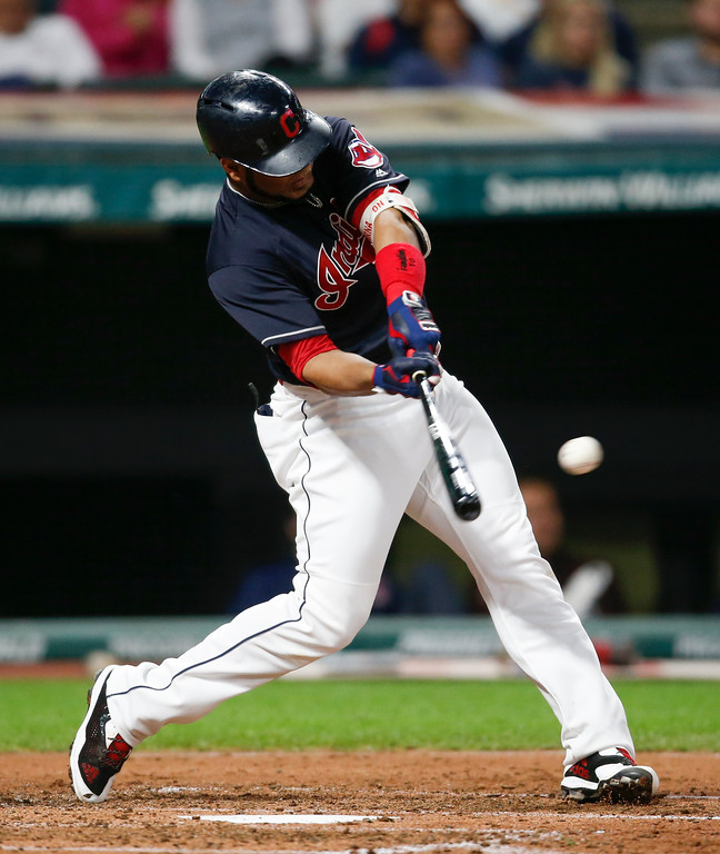 . Cleveland Indians\' Edwin Encarnacion singles off Minnesota Twins starting pitcher Adalberto Mejia during the fourth inning in a baseball game, Wednesday, Sept. 27, 2017, in Cleveland. (AP Photo/Ron Schwane)