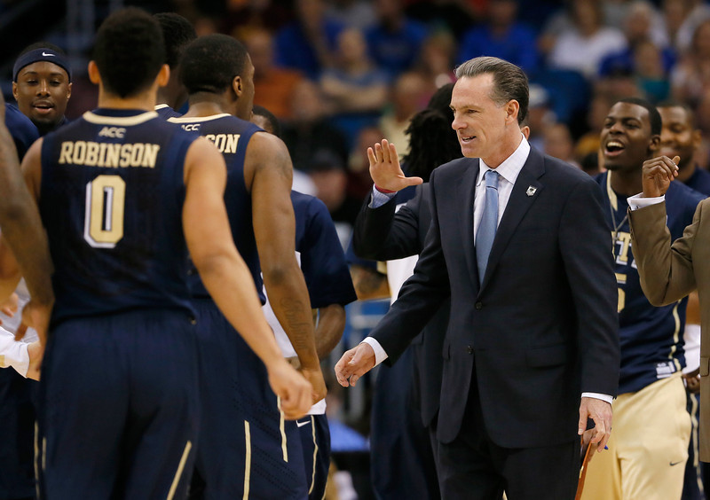 . Head coach Jamie Dixon of the Pittsburgh Panthers celebrates with his team in the first half against Colorado Buffaloes during the second round of the 2014 NCAA Men\'s Basketball Tournament at Amway Center on March 20, 2014 in Orlando, Florida.  (Photo by Kevin C. Cox/Getty Images)
