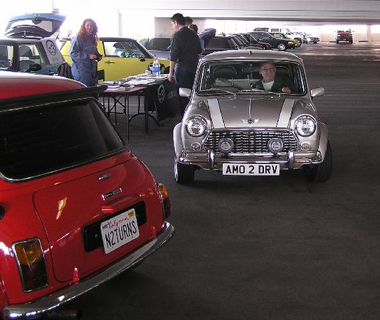 A couple of classic Minis. The red one has the steering wheel on the right side.