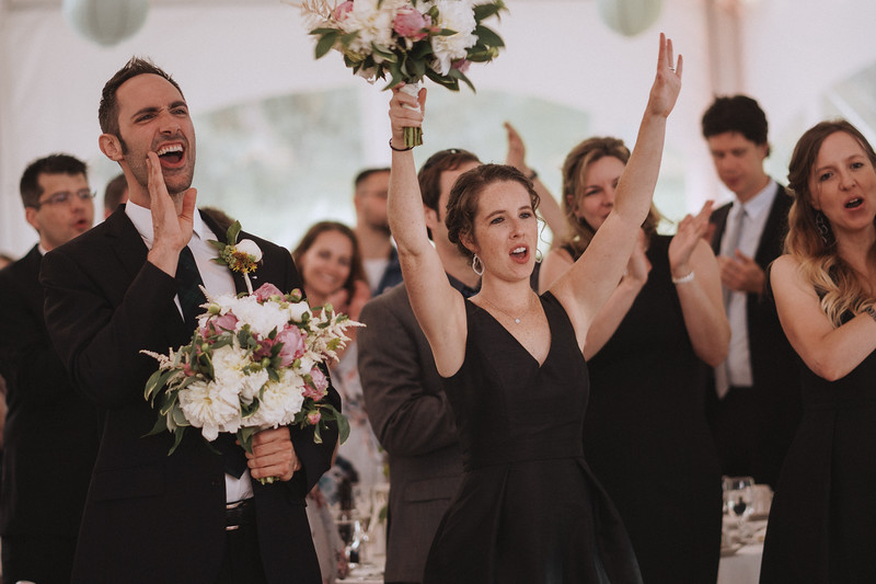The Mike of Honor and the bride's sister yell in celebration.