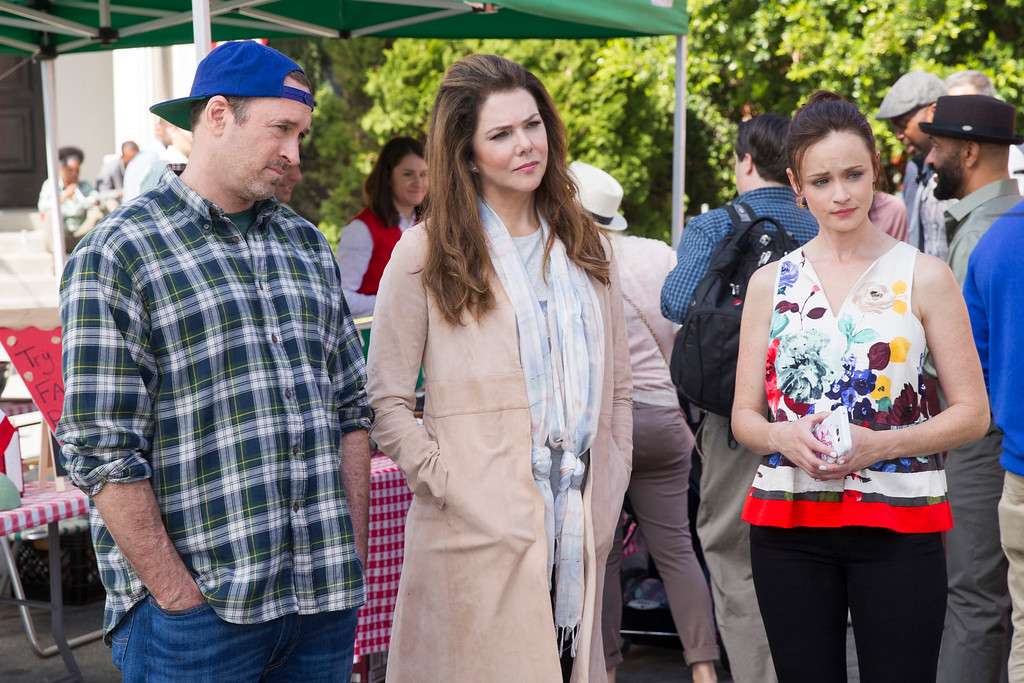 ". From left, Scott Patterson, Lauren Graham and Alexis Bledel appear in a scene from, ""Gilmore Girls: A Year In The Life,\"" premiering Nov. 25 on Netflix. (Saeed Adyani/Netflix via AP)"