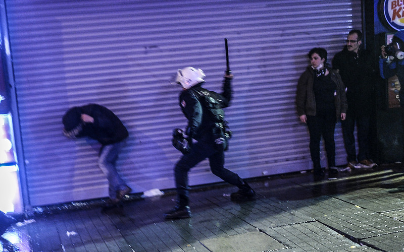 . A riot policeman beats a protestor during clashes between riot-police and protestors after the funeral of Berkin Elvan, the 15-year-old boy who died from injuries suffered during last year\'s anti-government protests, in Istanbul on March 12, 2014. Riot police fired tear gas and water cannon at protestors in the capital Ankara, while in Istanbul, crowds shouting anti-government slogans lit a huge fire as they made their way to a cemetery for the burial of Berkin Elvan. (BULENT KILIC/AFP/Getty Images)