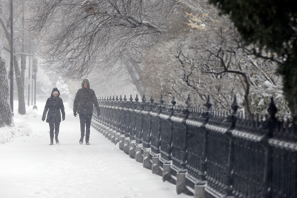 . A couple walks during a snowstorm, Tuesday, March 13, 2018, in Boston. (AP Photo/Michael Dwyer)