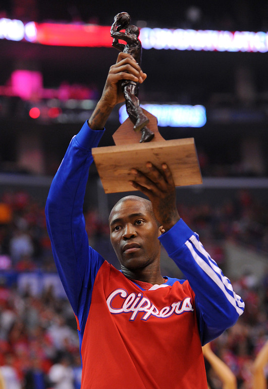 . The Clippers\' Jamal Crawford raises the NBA Sixth Man of the Year Award presented to him before their playoff game against the Thunder, Friday, May 9, 2014, at Staples Center. (Photo by Michael Owen Baker/Los Angeles Daily News)