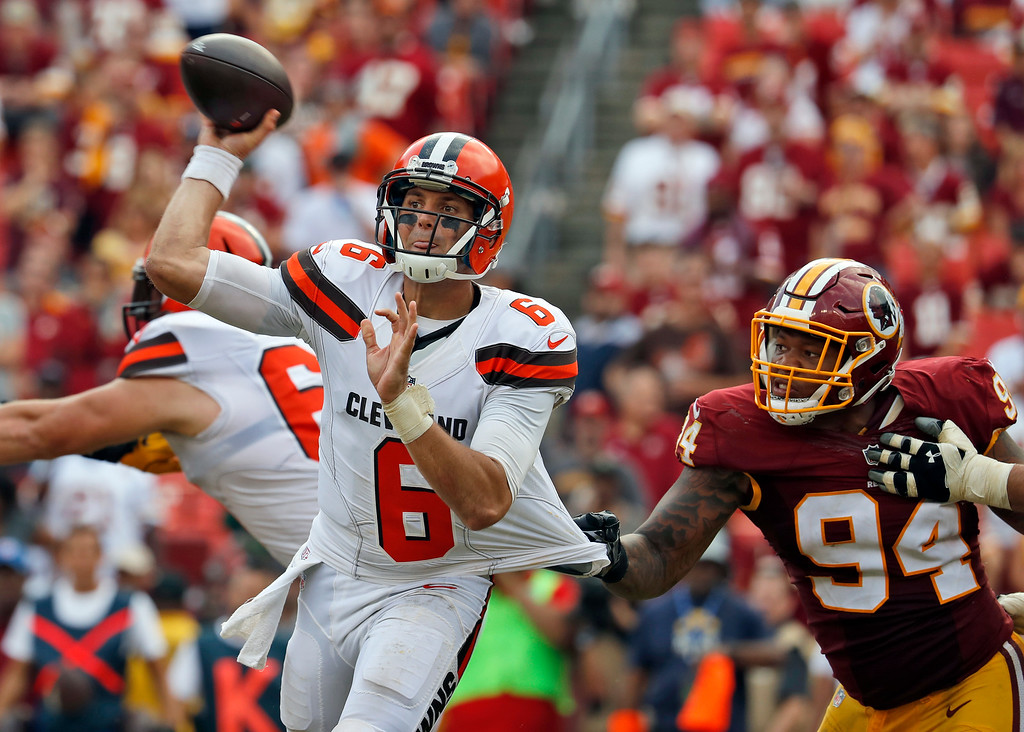 . Cleveland Browns quarterback Cody Kessler (6) throws as he is grabbed by Washington Redskins outside linebacker Preston Smith (94) during the second half of an NFL football game, Sunday, Oct. 2, 2016, in Landover, Md. The Redskins won 31-20. (AP Photo/Carolyn Kaster)