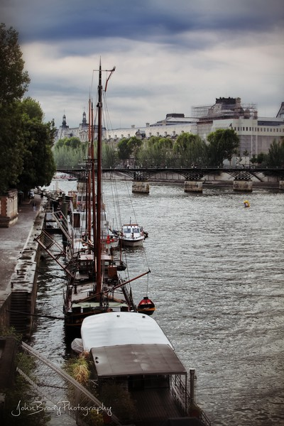 View of Seine River boats and the Pont des Art, the Bridge with the Locks on it - JohnBrody.com / John Brody Photography