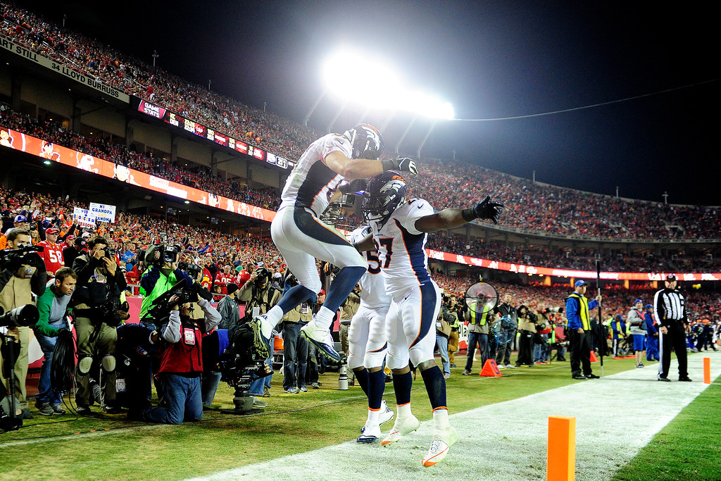 . Eric Decker (87) of the Denver Broncos celebrates his touchdown reception with Knowshon Moreno (27) during the second half of the Broncos\' 35-28 win at Arrowhead Stadium.   (Photo by AAron Ontiveroz/The Denver Post)