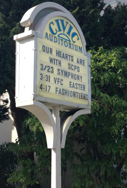 . The Santa Cruz Civic Auditorium pays tribute to Santa Cruz Police Department Wednesday morning. (Jessica M. Pasko/Sentinel)