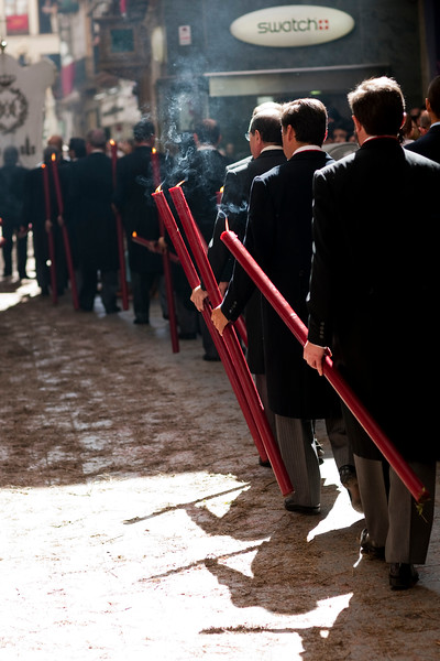 Brotherhood members carrying candles, Corpus Christi procession, Seville, Spain, 2009.