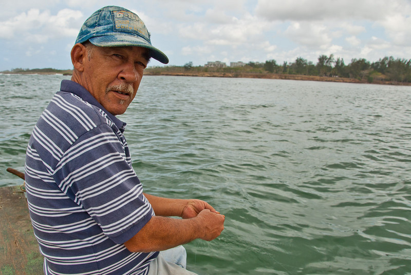 """Man fishing from dock.  """"The Old Man and the Sea"""", Hemingway's town, Cojimar, Cuba 2011"""