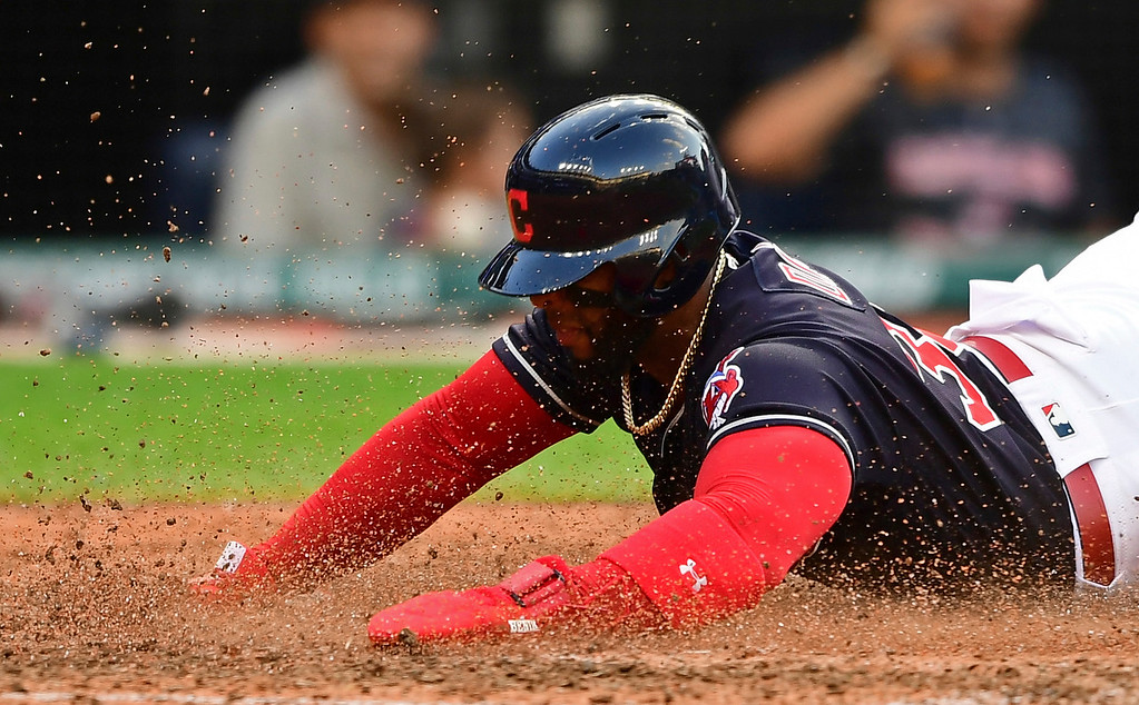 . Cleveland Indians\' Yandy Diaz scores a run on a two-RBI double by Melky Cabrera in the ninth inning of a baseball game against the Tampa Bay Rays, Sunday, Sept. 2, 2018, in Cleveland. The Rays won 6-4. (AP Photo/David Dermer)