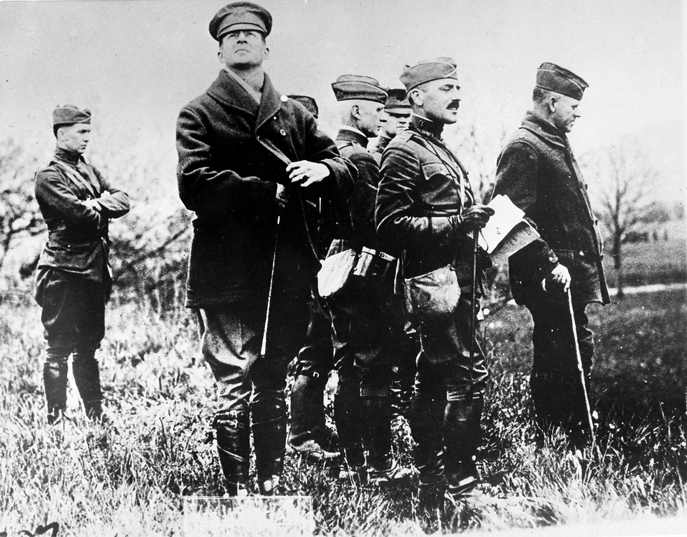 . Col. Douglas MacArthur, second from left, looking up, watches practice maneuvers with his staff at Baccarat, France, during the Great War, May 9, 1918. Major General Charles T. Menoher, right, with cane, was also in the group. (AP Photo)