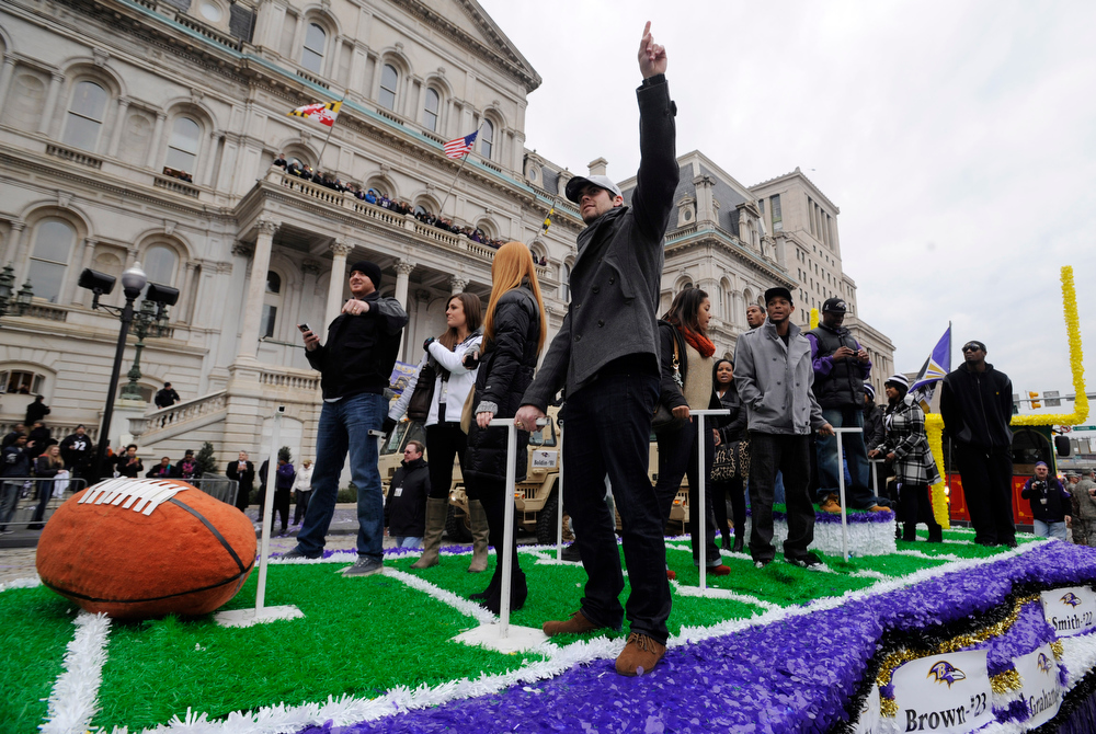 Description of . Baltimore Ravens rookie kicker Justin Tucker points to the sky at the start of  a victory parade outside of City Hall Tuesday, Feb. 5, 2013 in Baltimore. The Ravens defeated the San Francisco 49ers in NFL football\'s Super Bowl XLVII 34-31 on Sunday. (AP Photo/Gail Burton)