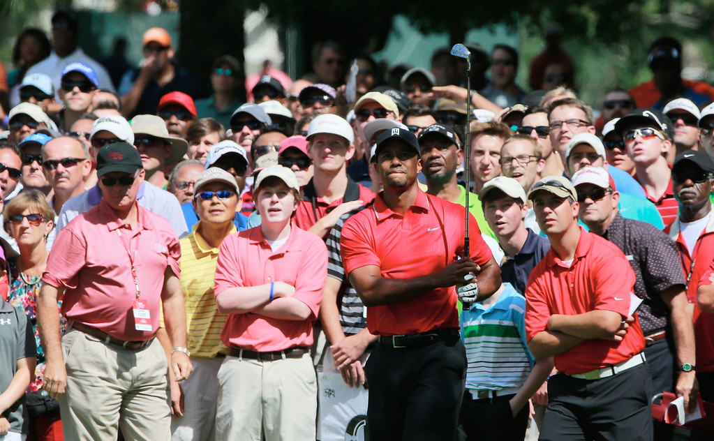 . ATLANTA, GA - SEPTEMBER 22:  Tiger Woods watches a shot on the third hole during the final round of the TOUR Championship by Coca-Cola at East Lake Golf Club on September 22, 2013 in Atlanta, Georgia.  (Photo by Sam Greenwood/Getty Images)