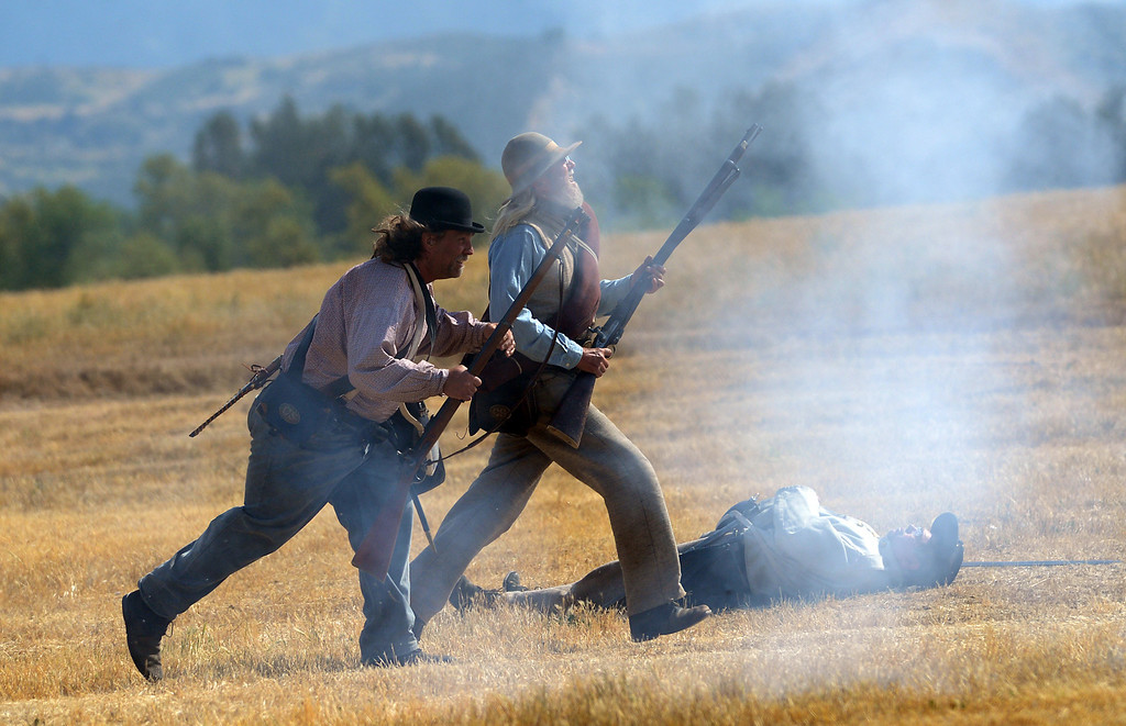 . 0408_NWS_IDB_L-CIVILWAR-02-JCM (Jennifer Cappuccio Maher/Staff Photographer) Confederate soldiers run into battle in the Southern California Civil War Association\'s Civil War reenactment Sunday, April 7, 2013, at Prado Regional Park in Chino.