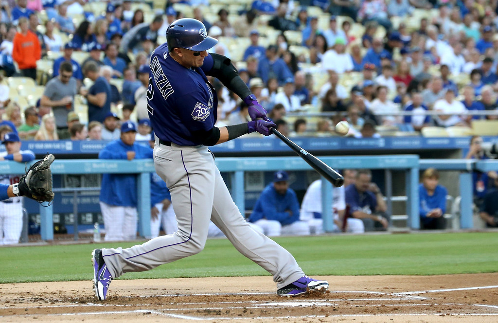 . LOS ANGELES, CA - JULY 12:   Troy Tulowitzki #2 of the Colorado Rockies hits a sacrifice fly to bring the Rockies\' first run in the first inning against the Los Angeles Dodgers at Dodger Stadium on July 12, 2013 in Los Angeles, California.  (Photo by Stephen Dunn/Getty Images)