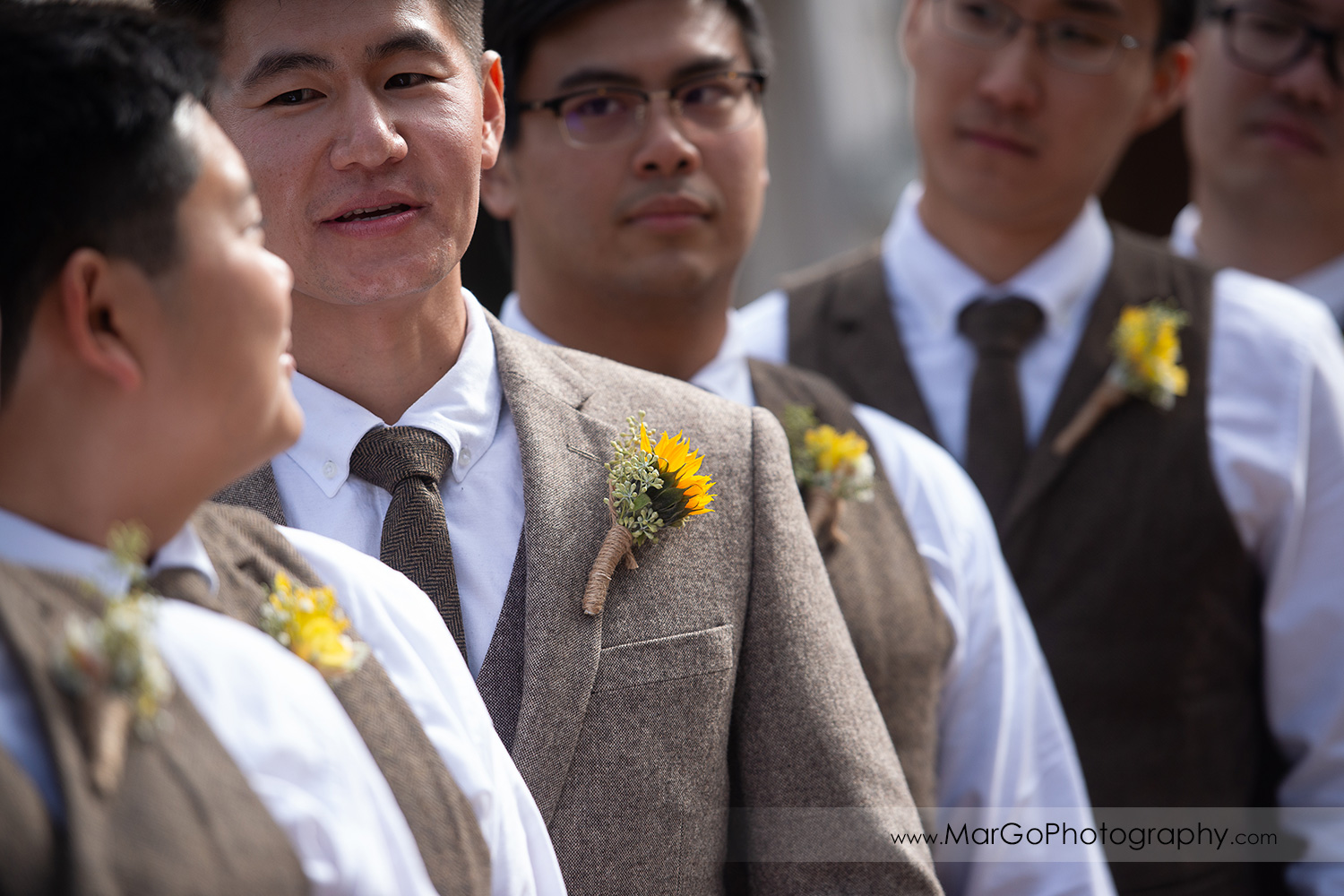 portrait of the groom through groomsmen at Long Branch Saloon & Farms in Half Moon Bay