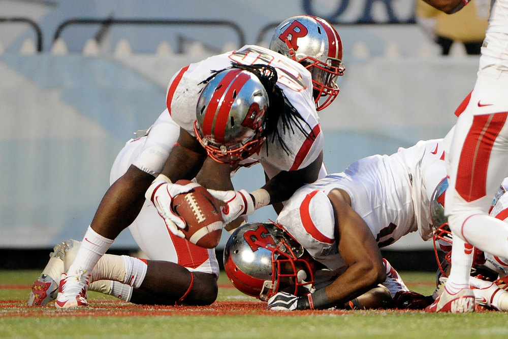 Description of . Rutgers linebacker Khaseem Greene (20) recovers a fumble in the end zone for a touchdown during the first quarter of the NCAA college football Russell Athletic Bowl game against Virginia Tech, Friday, Dec. 28, 2012, in Orlando, Fla. (AP Photo/Brian Blanco)