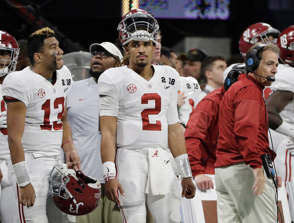 . Alabama\'s Jalen Hurts (2) is seen on the bench with Tua Tagovailoa (13) head coach Nick Saban during the second half of the NCAA college football playoff championship game against Georgia Monday, Jan. 8, 2018, in Atlanta. (AP Photo/David J. Phillip)