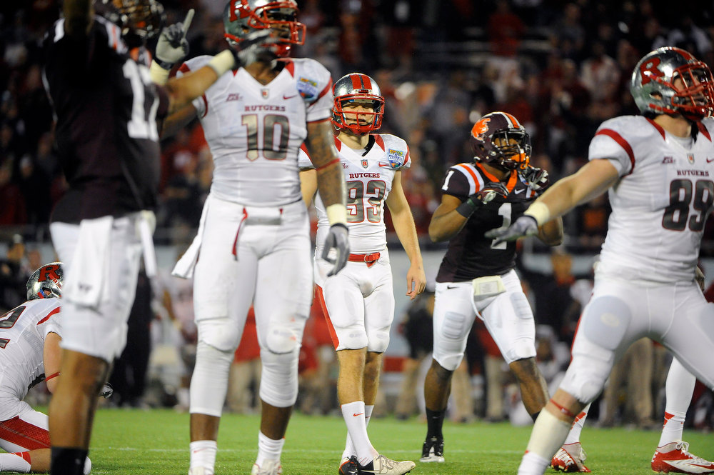 . Virginia Tech cornerbacks Kyle Fuller (17) and Antone Exum (1) look on as Rutgers kicker Nick Borgese (93) and tight ends D.C. Jefferson (10) and Paul Carrezola (89) react while watching Fuller\'s field goal-attempt go wide right in overtime at an NCAA college football Russell Athletic Bowl game on Friday, Dec. 28, 2012, in Orlando, Fla. Virginia Tech won 13-10. (AP Photo/Brian Blanco)
