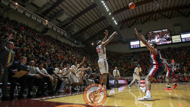 Zach Leday attempts a three point shot in front of the Virginia Tech bench. (Mark Umansky/TheKeyPlay.com)