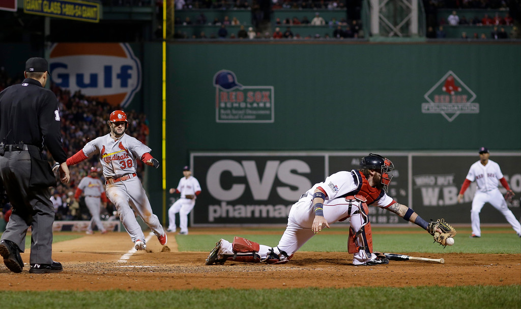 . St. Louis Cardinals\' Pete Kozma is safe at home as Boston Red Sox catcher Jarrod Saltalamacchia can\'t handle the throw during the seventh inning of Game 2 of baseball\'s World Series Thursday, Oct. 24, 2013, in Boston. (AP Photo/Matt Slocum)