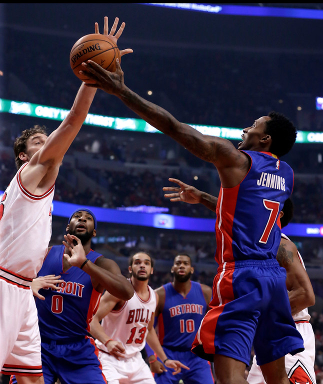 . Detroit Pistons guard Brandon Jennings (7) shoots past the out stretched hand of Chicago Bulls forward Pau Gasol, during the first half of an NBA basketball game Monday, Nov. 10, 2014, in Chicago. (AP Photo/Charles Rex Arbogast)
