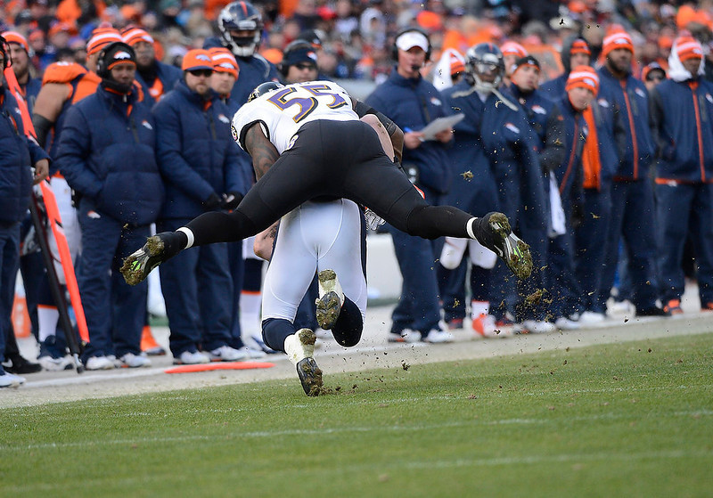 . Baltimore Ravens outside linebacker Terrell Suggs (55) takes down Denver Broncos tight end Joel Dreessen (81) after a catch in the second quarter. The Denver Broncos vs Baltimore Ravens AFC Divisional playoff game at Sports Authority Field Saturday January 12, 2013. (Photo by Joe Amon,/The Denver Post)