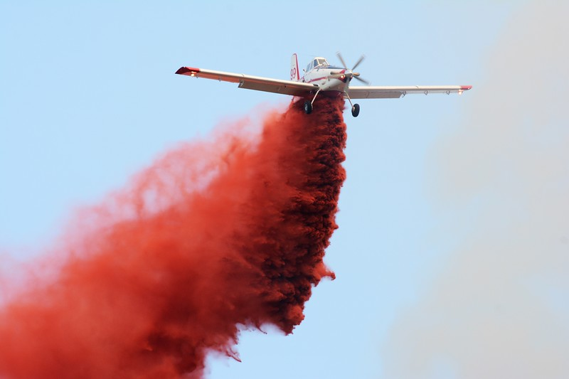 MT BOUCHERIE FIRE    6       GARY NYLANDER/The Daily Courier An air tanker drops retardant on a bush fire on Mount Boucherie Tuesday afternoon. Crews quickly attacked the blaze which started a few minutes after 3 pm. The blaze was about five hectares in size.