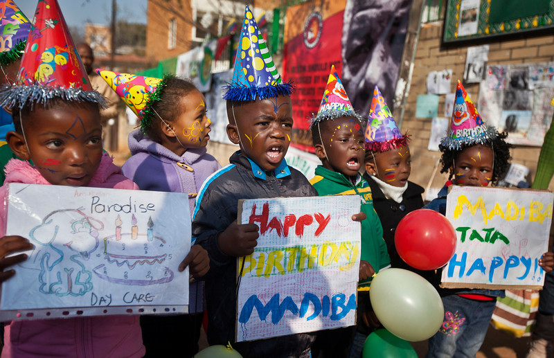. A group of kindergarten children sing Happy Birthday to Nelson Mandela outside the Mediclinic Heart Hospital where former South African President Nelson Mandela is being treated in Pretoria, South Africa Thursday, July 18, 2013. South Africa celebrated Nelson Mandela\'s 95th birthday on Thursday, a milestone capped by news that the former president\'s health was improving after fears that he was close to death during ongoing hospital treatment. (AP Photo/Ben Curtis)