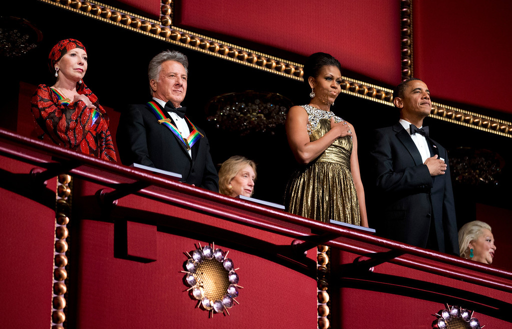 . President Barack Obama, right, and first lady Michelle Obama, second from right, with the 2012 Kennedy Center Honors recipients, ballerina Natalia Makarova, left, and actor and director Dustin Hoffman, stand as the National Anthem is played during the Kennedy Center Honors Gala at the Kennedy Center in Washington, Sunday, Dec. 2, 2012. (AP Photo/Manuel Balce Ceneta)