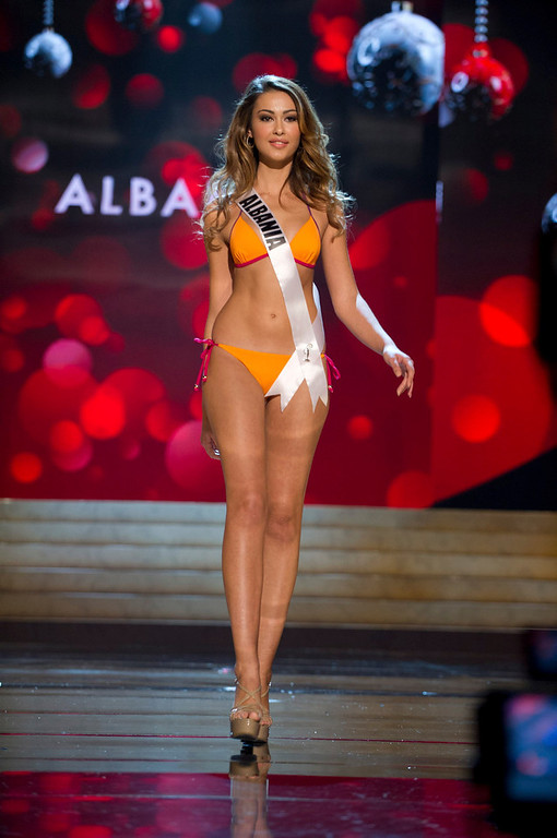 . Miss Albania Adrola Dushi competes in her Kooey Australia swimwear and Chinese Laundry shoes during the Swimsuit Competition of the 2012 Miss Universe Presentation Show at PH Live in Las Vegas, Nevada December 13, 2012. The 89 Miss Universe Contestants will compete for the Diamond Nexus Crown on December 19, 2012. REUTERS/Darren Decker/Miss Universe Organization/Handout