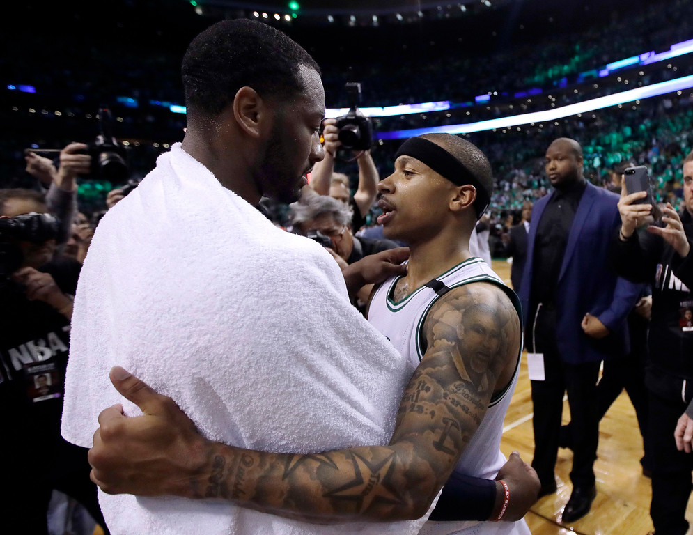 . Washington Wizards guard John Wall, left, and Boston Celtics guard Isaiah Thomas speak on the court after Game 7 of a second-round NBA basketball playoff series, Monday, May 15, 2017, in Boston. The Celtics won 115-105 to advance to the Eastern Conference championship series. (AP Photo/Charles Krupa)