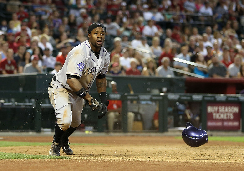 . Eric Young Jr. #1 of the Colorado Rockies reacts after scoring a run against the Arizona Diamondbacks during the sixth inning of the MLB game at Chase Field on April 28, 2013 in Phoenix, Arizona.  (Photo by Christian Petersen/Getty Images)