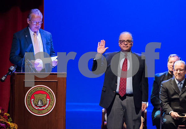 11/14/17 Wesley Bunnell | Staff The inauguration of Mayor Erin E. Stewart and other elected officials was held on Tuesday morning at New Britain High School. Town and City Clerk Mark H. Bernacki, L, gives the oath to Treasurer Ronald Jakubowski.