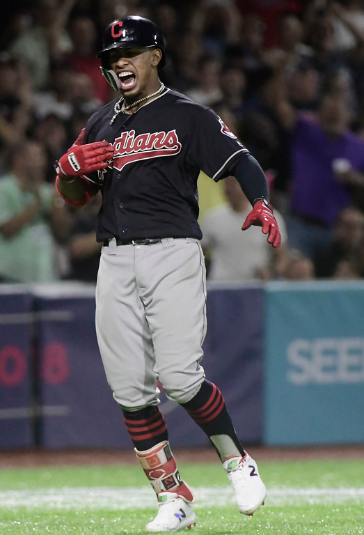 . CORRECTS RIVAL TEAM TO MINNESOTA TWINS - Cleveland Indians\' infielder Francisco Lindor celebrates a home run against the Minnesota Twins during the fifth inning of game one of a two-game MLB Series at Hiram Bithorn Stadium in San Juan, Puerto Rico, Tuesday, April 17, 2018. (AP Photo/Carlos Giusti)