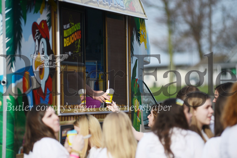 Students began filing in and finding their places at corn hole games and the ice cone truck outside, pictured here.