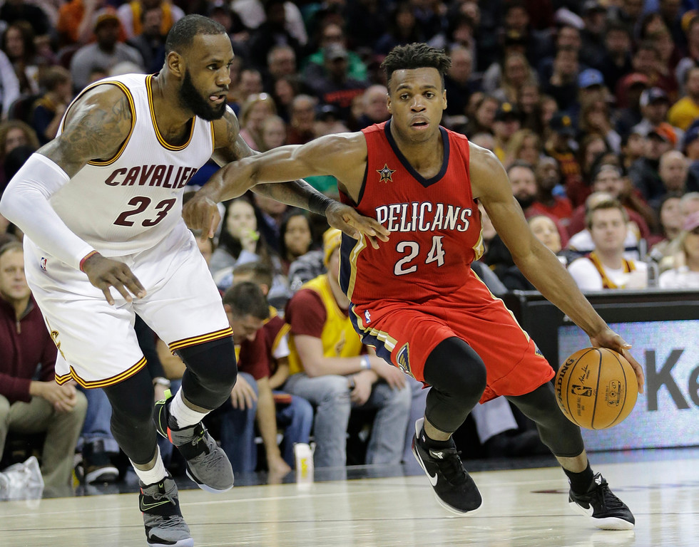 . New Orleans Pelicans\' Buddy Hield (24), from Bahamas, drives against Cleveland Cavaliers\' LeBron James (23) in the second half of an NBA basketball game, Monday, Jan. 2, 2017, in Cleveland. The Cavaliers won 90-82. (AP Photo/Tony Dejak)