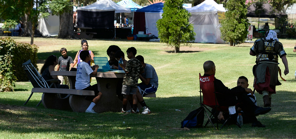 . Aug 31,2014, sylmar CA. People keep cool in the shade during the 2014 Sylmar Olive Festival.  Photo by Gene Blevins/LA DailyNews