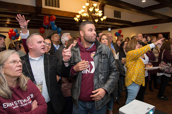 11/05/19 Wesley Bunnell | StaffrrCandidates for public office running under the Team Stewart ticket gathered at the Back Nine Tavern at Stanley Golf Course on Tuesday evening to celebrate Stewart's victory and the Republicans taking back a majority of seats on the city council. Robert Smedley, L, and Kristian Rosado watch as results come in.